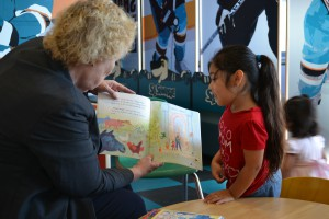 Representative Zoe Lofgren reads with Autumn, one of Valley Health Center Tully's pediatric patients.