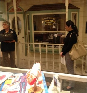 The VMC Foundation's Llisel Solis (right) listens to Docent Jan as she describes the display behind: A 1920's era doctor's office for tonsillectomies! In the foreground, educational displays of the circulatory system make kids' visits teachable moments.