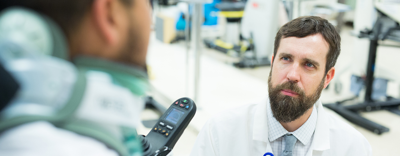 a doctor listening to someone talk in a hospital
