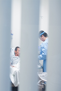 a healthcare worker in scrubs assisting a patient